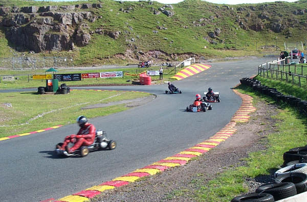 Tony Keele - John Esser - Rob Logan is on Shannon Gassons kart & Steave Greaves getting it together around paddock bend